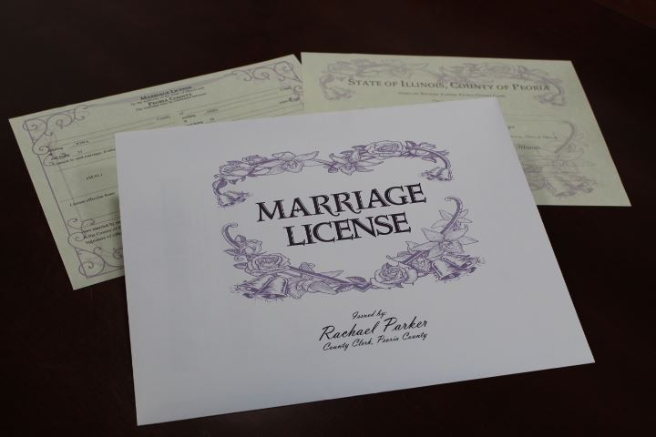 Marriage License with rings on top lying on a table